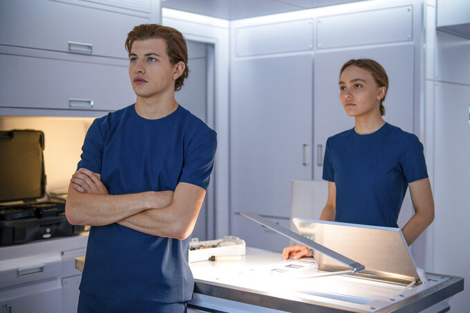 """This image released by Lionsgate shows Tye Sheridan, left, and Lily-Rose Depp in a scene from """"Voyagers."""" (Lionsgate via AP)"""
