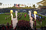 San Diego State football players enter the field before an NCAA football game against New Mexico Saturday, Oct. 9, 2021, in Carson, Calif. (AP Photo/Ashley Landis)