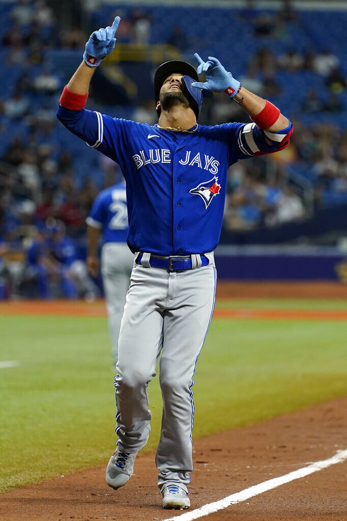 Toronto Blue Jays' Lourdes Gurriel Jr. celebrates his solo home run off Tampa Bay Rays' Drew Rasmussen during the fifth inning of a baseball game Tuesday, Sept. 21, 2021, in St. Petersburg, Fla. (AP Photo/Chris O'Meara)