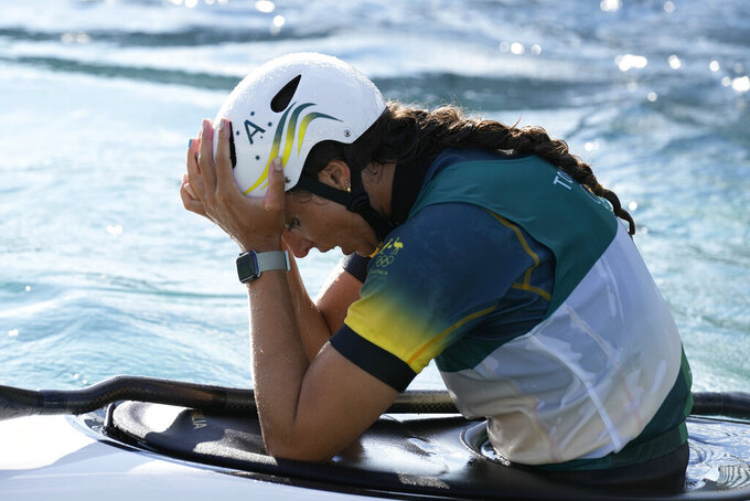 Jessica Fox of Australia reacts after crossing the finish line to win bronze in the Women's K1 of the Canoe Slalom at the 2020 Summer Olympics, Tuesday, July 27, 2021, in Tokyo, Japan. (AP Photo/Kirsty Wigglesworth)