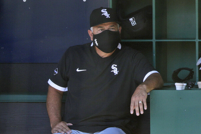Chicago White Sox manager Rick Renteria watches during the first inning in the first baseball game of a doubleheader against the Cleveland Indians, Tuesday, July 28, 2020, in Cleveland. (AP Photo/Tony Dejak)