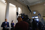Television reporters report at the Longworth House Office Building where former U.S. Ambassador to Ukraine Marie Yovanovitch is testifying to the House Intelligence Committee, Friday, Nov. 15, 2019, on Capitol Hill in Washington, in the second public impeachment hearing of President Donald Trump's efforts to tie U.S. aid for Ukraine to investigations of his political opponents. (AP Photo/Jacquelyn Martin)