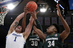 Kentucky forward Nate Sestina (1) vies for a rebound with Michigan State forwards Marcus Bingham Jr. (30) and Julius Marble (34) during the first half of an NCAA college basketball game Tuesday, Nov. 5, 2019, in New York. (AP Photo/Adam Hunger)