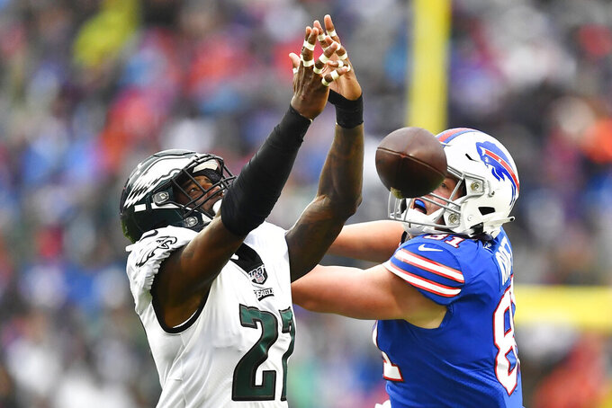 Philadelphia Eagles' Malcolm Jenkins, left, breaks up a pass intended for Buffalo Bills' Tyler Kroft, right, during the second half of an NFL football game, Sunday, Oct. 27, 2019, in Orchard Park, N.Y. (AP Photo/Adrian Kraus)
