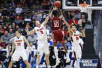Temple's Shizz Alston Jr. (10) shoots against Belmont's Dylan Windler (3) and Kevin McClain (11) during the first half of a First Four game of the NCAA college basketball tournament, Tuesday, March 19, 2019, in Dayton, Ohio. (AP Photo/John Minchillo)