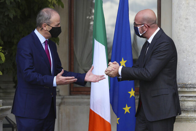 Ireland's Prime Minister Micheal Martin, left, welcomes the President of the European Council Charles Michel as he arrives for a press conference at Farmleigh House, Dublin, Thursday Oct. 8, 2020. (Brian Lawless/PA via AP)
