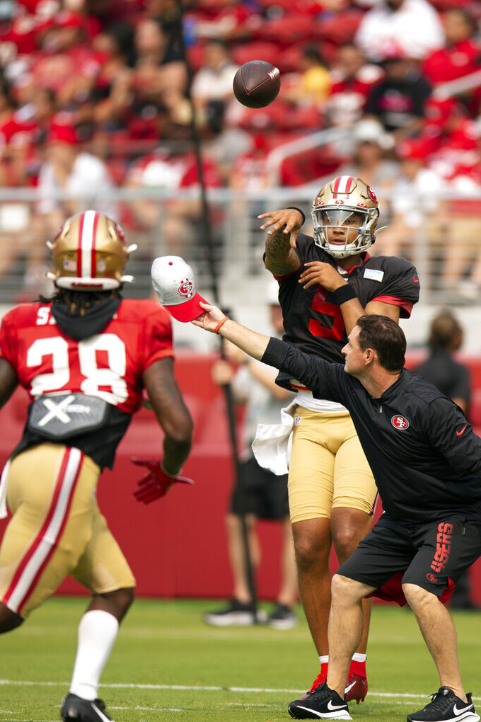 San Francisco 49ers quarterback Trey Lance (5) throws over simulated defensive pressure to running back Trey Sermon (28)during an NFL football open practice, Saturday, Aug. 7, 2021, in Santa Clara, Calif. (AP Photo/D. Ross Cameron)