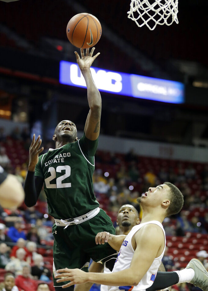 Colorado State's J.D. Paige shoots over Boise State's Alex Hobbs during the second half of an NCAA college basketball game in the Mountain West Conference tournament Wednesday, March 13, 2019, in Las Vegas. (AP Photo/Isaac Brekken)