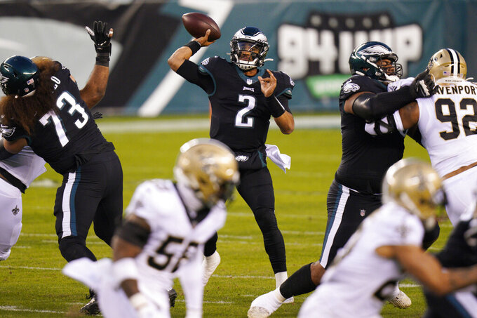 Philadelphia Eagles' Jalen Hurts passes during the first half of an NFL football game against the New Orleans Saints, Sunday, Dec. 13, 2020, in Philadelphia. (AP Photo/Chris Szagola)