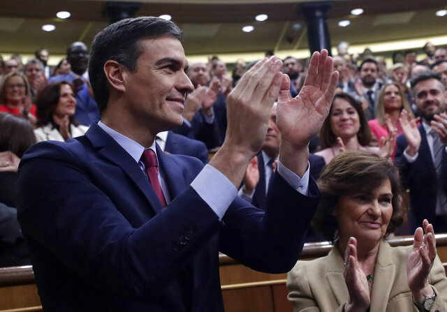 Spain's caretaker Prime Minister Pedro Sanchez applauds at the Spanish parliament in Madrid Tuesday, Jan. 7, 2020. Spain's parliament chose Socialist leader Pedro Sánchez to form a new government Tuesday, ending almost a year of political limbo for the eurozone's fourth-largest economy. Sánchez won a cliff-hanger confidence vote 167-165, with 18 abstentions. It was the slimmest victory for a prime minister candidate in decades.(AP Photo/Manu Fernandez)