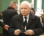 FILE- In this photo taken Oct. 21, 2018 in Warsaw, Poland, is seen the leader of Poland's ruling party Jaroslaw Kaczynski as he casts his ballot in local elections. Kaczynski, whose public image is of restraint and honesty, is at the center of a scandal involving him negotiating a multi-million euro construction project, even though the law bans political parties from doing business.(AP Photo/Czarek Sokolowski)