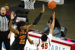 Oklahoma State forward Kalib Boone (22) blocks a shot by Iowa State guard Rasir Bolton (45) during the second half of an NCAA college basketball game, Monday, Jan. 25, 2021, in Ames, Iowa. Oklahoma State won 81-60. (AP Photo/Charlie Neibergall)
