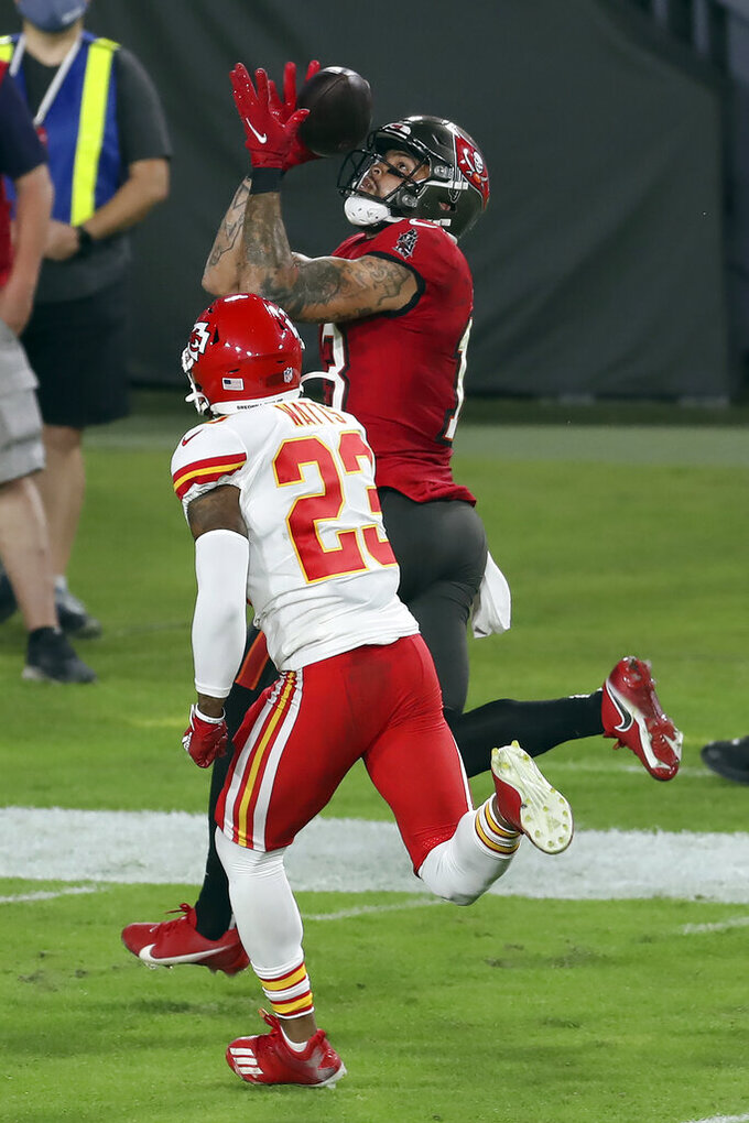 Tampa Bay Buccaneers wide receiver Mike Evans (13) beats Kansas City Chiefs safety Armani Watts (23) for a score during the second half of an NFL football game Sunday, Nov. 29, 2020, in Tampa, Fla. (AP Photo/Mark LoMoglio)