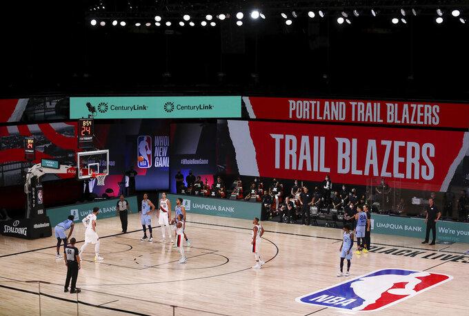 Portland Trail Blazers' Damian Lillard (0) shoots a free throw during the second half of an NBA basketball game against the Memphis Grizzlies, Friday, July 31, 2020, in Lake Buena Vista, Fla. (Mike Ehrmann/Pool Photo via AP)