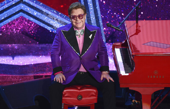 """FILE - Elton John is seen after performing """"(I'm Gonna) Love Me Again"""" nominated for the award for best original song from """"Rocketman"""" at the Oscars on Feb. 9, 2020, at the Dolby Theatre in Los Angeles. John is releasing an album of collaborations with artists from several generations and genres, including Nicki Minaj, Young Thug, Miley Cyrus, Lil Nas X, Stevie Nicks and Stevie Wonder. """"The Lockdown Sessions,"""" a collection of 16 songs featuring John with artists from Dua Lipa to the late Glen Campbell, will be released on Oct. 22.  (AP Photo/Chris Pizzello, File)"""