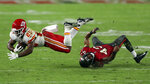 Kansas City Chiefs running back Clyde Edwards-Helaire (25) gets tripped up by Tampa Bay Buccaneers defensive back Ross Cockrell (43) during the second half of an NFL football game Sunday, Nov. 29, 2020, in Tampa, Fla. (AP Photo/Mark LoMoglio)