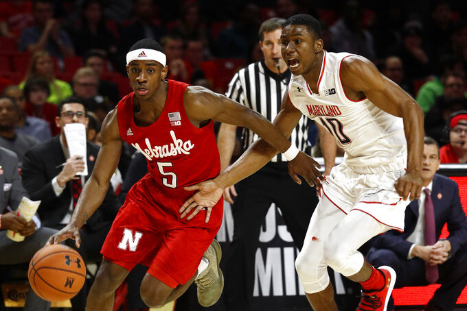 Nebraska guard Glynn Watson Jr., left, drives past Maryland guard Serrel Smith Jr. in the first half of an NCAA college basketball game, Wednesday, Jan. 2, 2019, in College Park, Md. (AP Photo/Patrick Semansky)