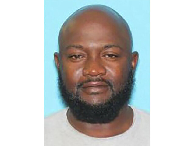 This booking photo provided by Kinston Police Department shows Venice Taylor of Jacksonville, NC. Police in North Carolina have arrested a Taylor, accused of dousing a woman in flammable liquid and lighting her on fire while she drove alone in her car.  He was taken into custody hours later, during a traffic stop in Kinston on Monday, Feb. 3, 2020, news outlets reported.  (Kinston Police Department via AP)