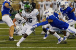 Tulane running back Stephon Huderson (5) carries past Tulsa safety TieNeal Martin (7) during the second half of an NCAA college football game in Tulsa, Okla., Thursday, Nov. 19, 2020. (AP Photo/Sue Ogrocki)