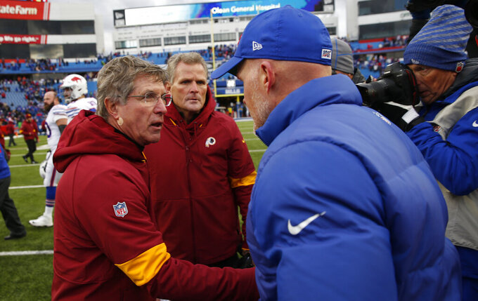 Washington Redskins head coach Bill Callahan, left, congratulates Buffalo Bills head coach Sean McDermott after an NFL football game, Sunday, Nov. 3, 2019, in Orchard Park, N.Y. (AP Photo/John Munson)