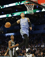 U.S. Team's Kyle Kuzma, of the Los Angeles Lakers heads to the hoop for a dunk against the World Team during the NBA All-Star Rising Stars basketball game, Friday, Feb. 15, 2019, in Charlotte, N.C. (AP Photo/Chuck Burton)