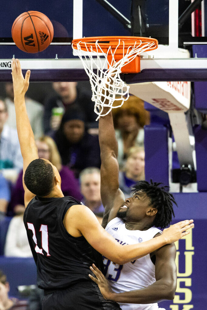 Seattle guard Riley Grigsby (11) misses the basket as Washington forward Isaiah Stewart (33) defends during the first half of an NCAA college basketball game, Tuesday, Dec. 17, 2019, in Seattle. (Andy Bao/The Seattle Times via AP)