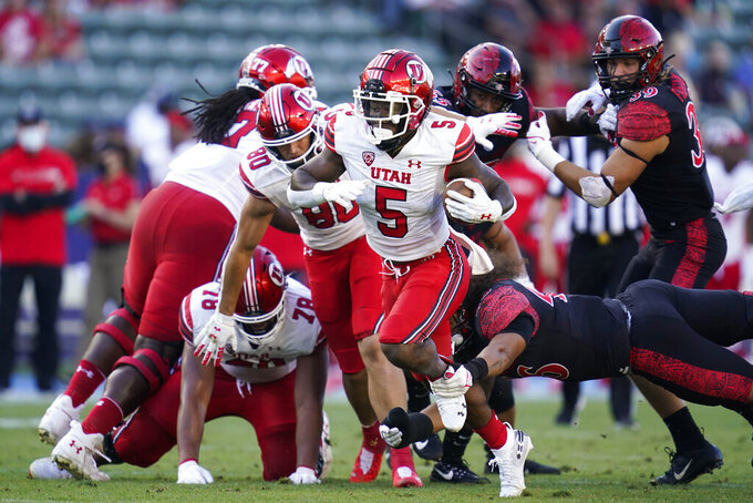 Utah running back TJ Pledger (5) is tripped up by San Diego State linebacker Michael Shawcroft (46) during the first half of an NCAA college football game Saturday, Sept. 18, 2021, in Carson, Calif. (AP Photo/Ashley Landis)
