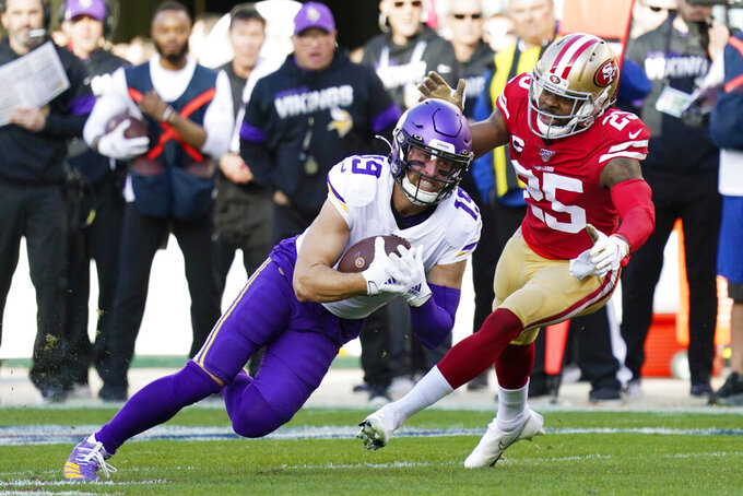FILE - In this Jan. 11, 2020, file photo, Minnesota Vikings wide receiver Adam Thielen (19) is tackled by San Francisco 49ers cornerback Richard Sherman (25) during the first half of an NFL divisional playoff football game in Santa Clara, Calif. Thielen has a lot of work to do this season, trying to make up for lost injury time last season, overcome the departure of pal Stefon Diggs and lead an inexperienced group. (AP Photo/Tony Avelar, File)
