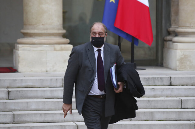 French Justice Minister Eric Dupond-Moretti leaves the weekly Cabinet meeting at the Elysee Palace in Paris, Wednesday, Des. 9, 2020. A draft law aimed at arming France against Islamist radicalism was unveiled at Wednesday's weekly Cabinet meeting, a measure promoted by President Emmanuel Macron to rout out what he calls