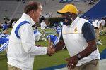 Duke head coach David Cutcliffe, left, and North Carolina A&T head coach Sam Washington shake hands before an NCAA college football game in Durham, N.C., Friday, Sept. 10, 2021. (AP Photo/Chris Seward)