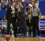 Kansas head coach Bill Self, left, is held by assistant coach Kurtis Townsend after being called for a technical foul by referee Marques Pettigrew, right, during the first half of an NCAA college basketball game against Louisiana Lafayette in Lawrence, Kan., Friday, Nov. 16, 2018. (AP Photo/Orlin Wagner)