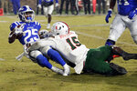 FILE - In this Nov. 30, 2019, file photo, Miami's Gregory Rousseau (15) tackles Duke's Deon Jackson (25) during the second half of an NCAA college football game between Miami and Duke in Durham, N.C. With Oregon's Penei Sewell likely to be long gone, two other heralded tackles could be available to the Vikings at No. 14: Northwestern's Rashawn Slater and Virginia Tech's Christian Darrisaw. Slater has a random connection to Minnesota: His father, Reggie Slater, played in the NBA for the Timberwolves in parts of two seasons. (AP Photo/Chris Seward, File)