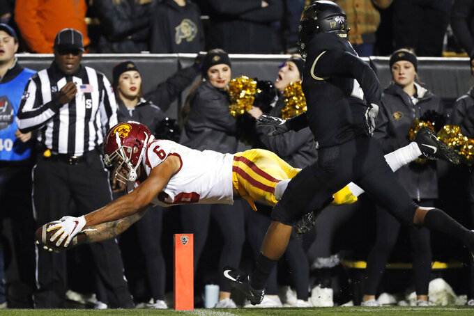 FILE - In this Oct. 25, 2019, file photo, Southern California wide receiver Michael Pittman Jr. dives into the end zone to score a touchdown after pulling in a pass in front of Colorado safety Mikial Onu during the second half of an NCAA college football game, in Boulder, Colo. Pittman was selected to The Associated Press All-Pac 12 Conference team, Thursday, Dec. 12, 2019.  (AP Photo/David Zalubowski, File)