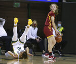 Iowa State guard Emily Ryan, right, looks over her shoulder as Baylor guard Jaden Owens flips over during a play in the second half of an NCAA college basketball game, Saturday, Jan. 16, 2021, in Waco, Texas. (Rod Aydelotte/Waco Tribune-Herald via AP)