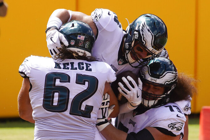 Philadelphia Eagles tight end Zach Ertz, center, celebrates his touchdown with teammates center Jason Kelce (62) and during the first half of an NFL football game against the Washington Football Team Sunday, Sept. 13, 2020, in Landover, Md. (AP Photo/Al Drago)