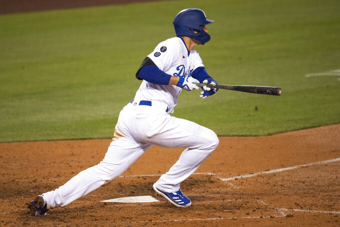 Los Angeles Dodgers' Corey Seager breaks from the batter's box with a two-run single during the sixth inning of the team's baseball game against the San Diego Padres in Los Angeles, Saturday, April 24, 2021. (AP Photo/Kyusung Gong)