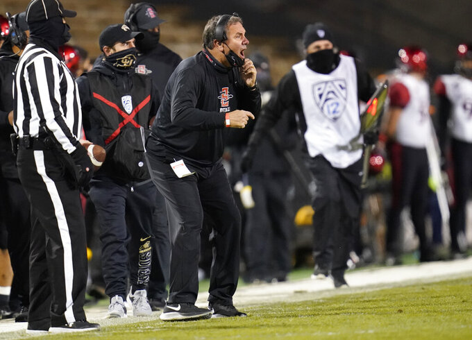 San Diego State coach Brady Hoke, center, shouts during the second half of the team's NCAA college football game against Colorado on Saturday, Nov. 28, 2020, in Boulder, Colo. (AP Photo/David Zalubowski)