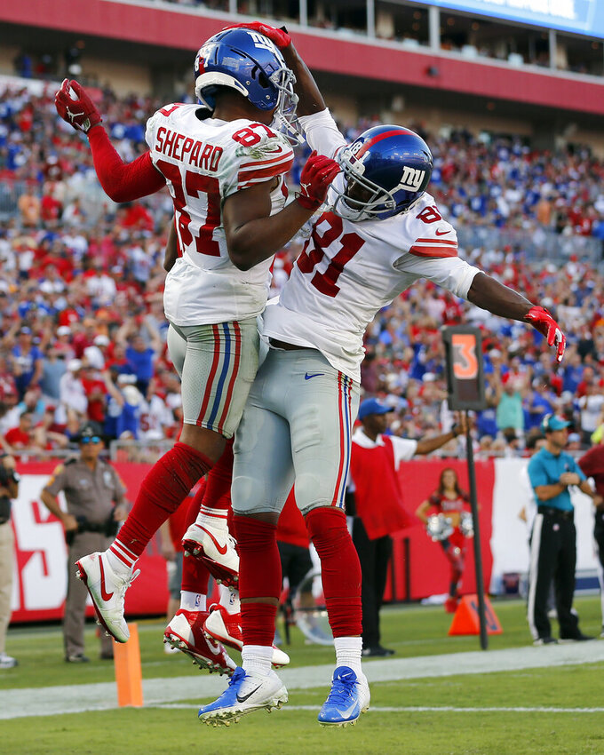 New York Giants wide receiver Sterling Shepard (87) celebrates his touchdown against the Tampa Bay Buccaneers with wide receiver Russell Shepard (81) during the second half of an NFL football game Sunday, Sept. 22, 2019, in Tampa, Fla. (AP Photo/Mark LoMoglio)