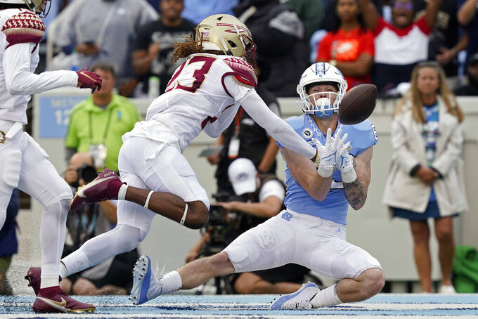 North Carolina wide receiver Justin Olson misses a pass in the end zone as Florida State defensive back Sidney Williams (23) defends during the first half of an NCAA college football game in Chapel Hill, N.C., Saturday, Oct. 9, 2021. (AP Photo/Gerry Broome)