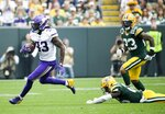 Minnesota Vikings' Dalvin Cook breaks away from Green Bay Packers' Darnell Savage for a touchdown run during the first half of an NFL football game Sunday, Sept. 15, 2019, in Green Bay, Wis. (AP Photo/Mike Roemer)