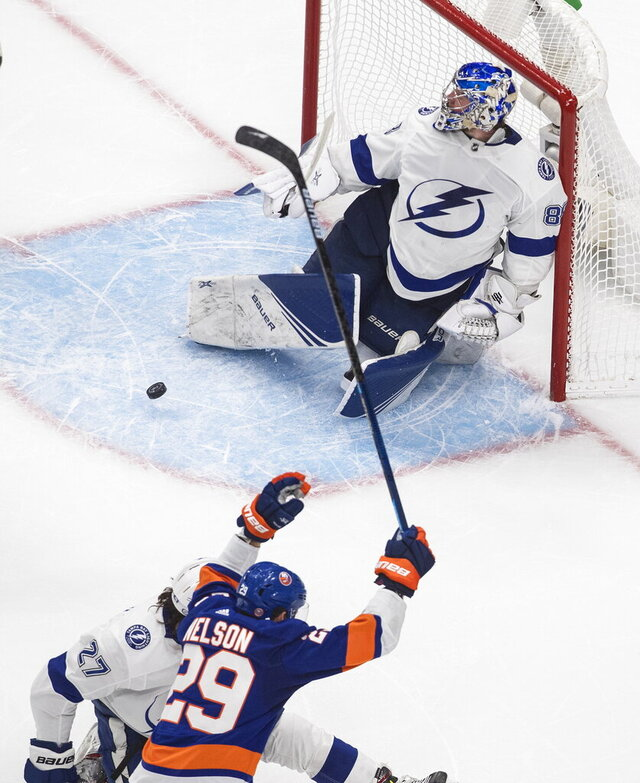 New York Islanders' Brock Nelson (29) celebrates his goal on Tampa Bay Lightning goalie Andrei Vasilevskiy (88) during the third period of Game 3 of the NHL hockey Eastern Conference final, Friday, Sept. 11, 2020, in Edmonton, Alberta. (Jason Franson/The Canadian Press via AP)