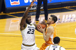 Tennessee's John Fulkerson, right, gets tangled up with Missouri's Jeremiah Tilmon, left, as he shoots during the first half of an NCAA college basketball game Wednesday, Dec. 30, 2020, in Columbia, Mo. (AP Photo/L.G. Patterson)