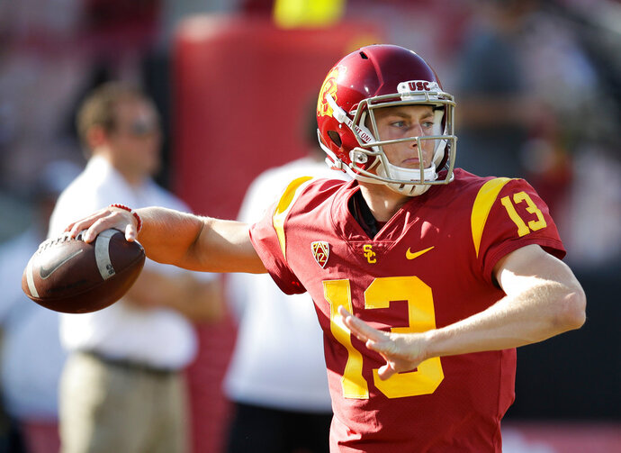 FILE - In this Sept. 9, 2017, file photo, Southern California quarterback Jack Sears warms up before the team's NCAA college football game against Stanford in Los Angeles. Matt Fink and Sears completed USC's spring football workouts in close competition for the chance to replace Sam Darnold as starting quarterback later this year. The competition will heat up in the summer when top recruit J.T. Daniels graduates from high school and joins the Trojans' quarterback group. (AP Photo/Jae C. Hong, File)