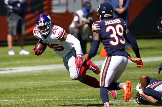New York Giants running back Saquon Barkley (26) runs against the Chicago Bears during the first half of an NFL football game in Chicago, Sunday, Sept. 20, 2020. (AP Photo/Charles Rex Arbogast)