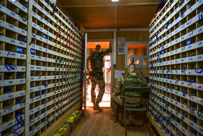 Estonian Barkhane force soldiers man the entrance of the base in Gao, Mali Sunday June 6, 2021. French President Emmanuel Macron announced at a press conference Thursday June 10, 2021 That operation Barkhane would end and be replaced by support for local partners and counter terrorism. (AP Photo/Jerome Delay)