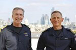 Daniel Craig, right, receives the honorary Royal Navy rank of Commander from the Head of the Royal Navy, First Sea Lord Admiral Sir Tony Radakin KCB ADC, left, in London, Wednesday Sept. 22, 2021. (LPhot Lee Blease/Ministry of Defence via AP)