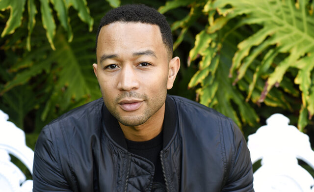 FILE - This Nov. 21, 2016 file photo shows singer-songwriter John Legend during a portrait session in West Hollywood, Calif. Legend is nominated for a Grammy for best traditional pop vocal album with his holiday album,
