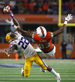 Miami wide receiver Evidence Njoku (83) and LSU cornerback Kristian Fulton (22) compete for a pass during the second half of an NCAA college football game Sunday, Sept. 2, 2018, in Arlington, Texas. The pass was incomplete. LSU won 33-17. (AP Photo/Ron Jenkins)