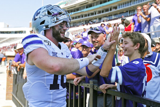Kansas State quarterback Skylar Thompson (10) is congratulated by a young fan following their NCAA college football game win 31-24 over Mississippi State in Starkville, Miss., Saturday, Sept. 14, 2019. (AP Photo/Rogelio V. Solis)