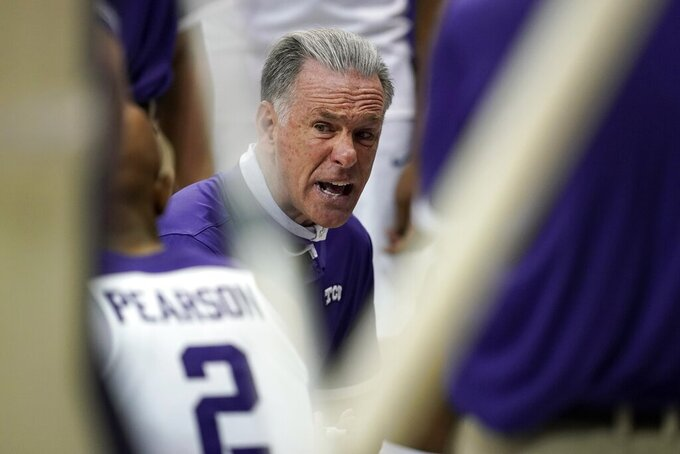 TCU coach Jamie Dixon talks to forward Mickey Pearson (2) and the rest of the team during a timeout in the second half of an NCAA college basketball game against Northwestern State in Fort Worth, Texas, Thursday, Dec. 3, 2020. (AP Photo/Tony Gutierrez)